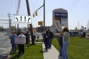 Protesters outside a Walmart in Toledo, Ohio. The world's largest retailer has made a huge effort to improve its CSR profile, but its record remains mixed.