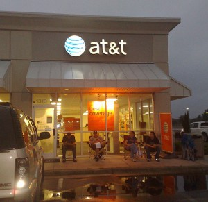 Customers reserve spots outside an AT&T store for the release of a new iPhone, which has contributed to a 20,000 percent increase in data traffic on AT&T's networks since 2007.